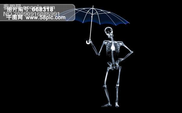 黑色背景骷髅惬意打伞